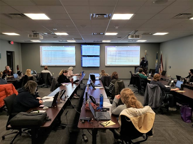 Workers are shown here Friday calling people who have registered for the COVID-19 vaccine to come and get their shot. Fairfield County Emergency Management Agency Director Jon Kochis said some people are not answering the phone when called. Callers will try four times before giving up on someone.