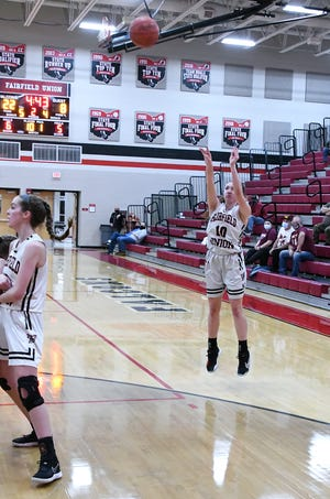 Fairfield Union's Olivia Spillers attempts a 3-point shot in the first half against Meigs during a Division II Southeast sectional final Thursday night at FUHS. The host Falcons won 66-37. -Jamie Potts/Eagle Gazette