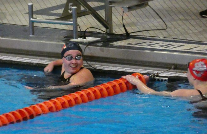 Fairfield Christian junior Grace Barnhart smiles after her victory in the 200 freestyle Thursday during the Division II district meet at Bowling Green State University. The district title qualified her for the state meet.