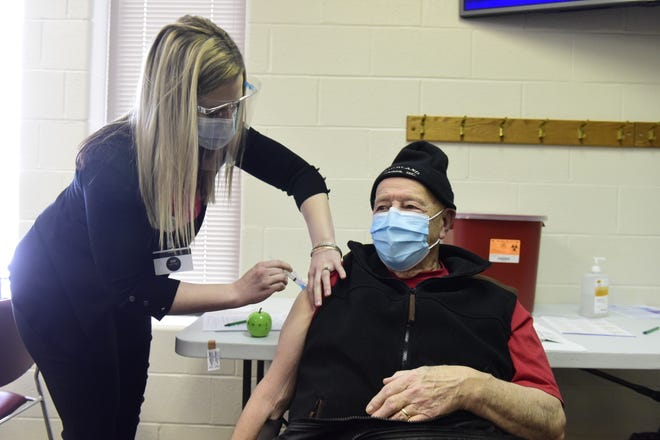 Wayne Beal, 87, of Madison Township, received his second dose of the COVID-19 vaccine in February from Caitlyn Boroff, a public health nurse at Richland Public Health.