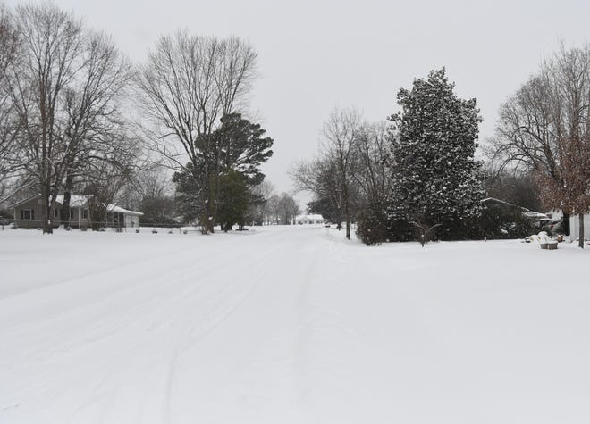 A heavy blanket of snow makes E. 6th Street in Mountain Home disappear on the morning of Wednesday, Feb. 17, 2021. The Twin Lakes Area received almost 10 inches of snow over the week, leading several area school districts to declare old-fashioned snow days instead of requiring students to complete assignments online.