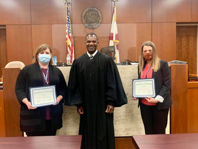 Judge Calvin Williams swore in Jana Krause and Mary Mangum on February 4, 2021, as volunteers for CASA of Montgomery County.