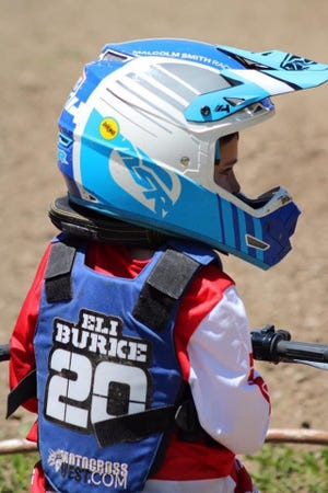 Eli Burke prepares to race on a dirt bike track. Eli, a 7-year-old from Yorktown, has been riding dirt bikes since he was 2-and-a-half years old.