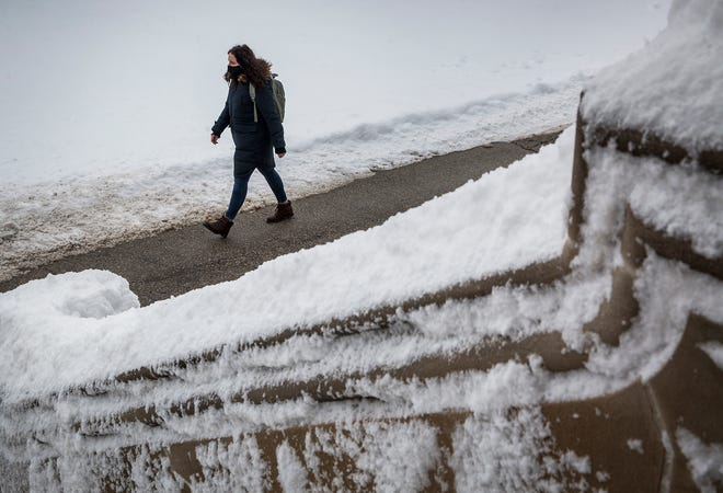 Residents of Delaware County brave heavy snow in February, 2021. Up to three inches of snow is expected with an April snowstorm moving into the area Tuesday night.