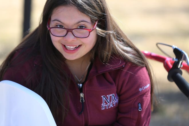 Zia Middle School student Grace Holguin on her special needs trike, Friday, Feb. 19, 2021.