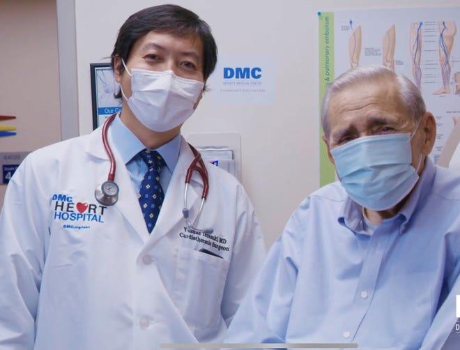 Dr. Yusuke Terasaki, DMC cardiothoracic surgeon, with Gene Cabadas of South Lyon. Cabadas had life-saving heart surgery at DMC in August 2020.