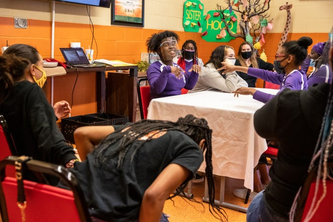 Janiah Williams, 12, center, causes her classmates to erupt in laughter while participating in a role-playing exercise during the Rites of Passage program at the Building Resilience in African American Families youth facility in Palm Springs, Calif., on February 17, 2021.