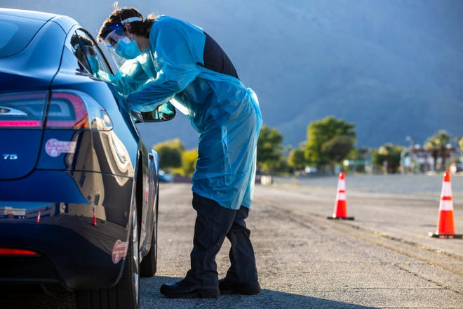 Emergency Medical Technician Anthony Medina administers a COVID-19 test at the drive-up COVID-19 Clinic in Palm Springs, California. In Wichita County there was one COVID-related death and 11 new cases reported Friday, Feb. 26.