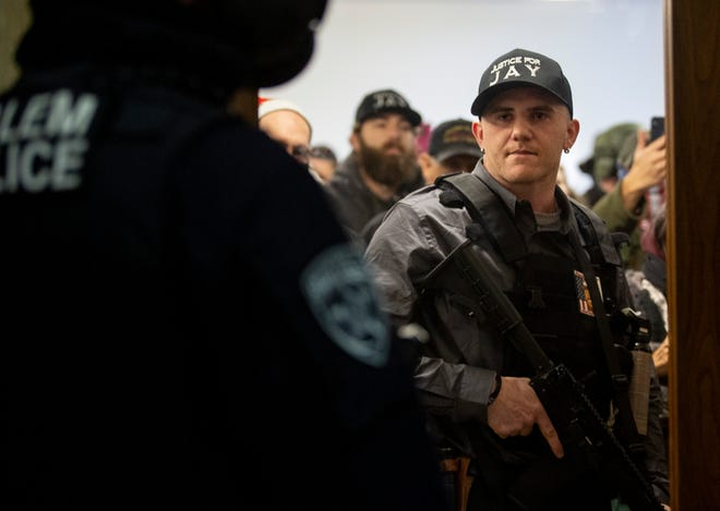 Chandler Pappas, a member of the far-right group Patriot Prayer, is seen facing off with Salem Police after breaching the Oregon State Capitol with a group of anti-lockdown protesters on Dec. 21, 2020.