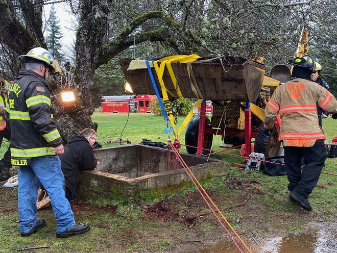 Salem Fire Department's rope rescue team was called in to help pull a woman out of a 55-foot well near Scotts Mills on Thursday, Feb. 18, 2021.