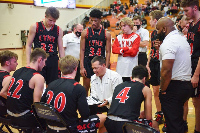 Brandon Valley basketball coach Brent Deckert talks to his players in a huddle between quarters on Thursday, Feb. 18, at Roosevelt High School in Sioux Falls.