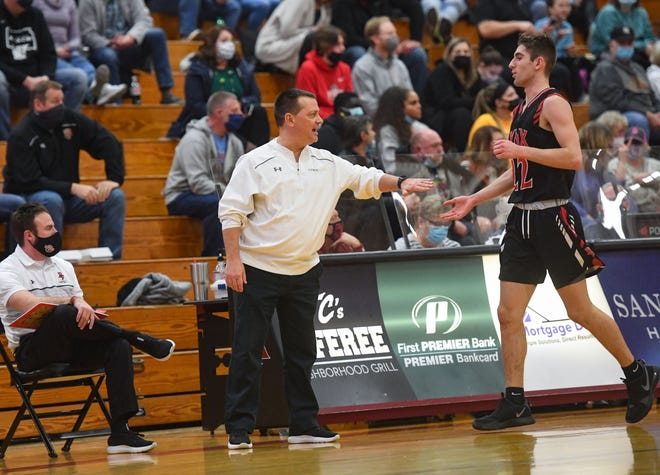 Brandon Valley basketball coach Brent Deckert greets Aydin Lloyd as he comes off the court during a game on Thursday, Feb. 18, at Roosevelt High School in Sioux Falls.