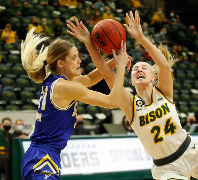 North Dakota State's Abby Schulte drives to the basket and is fouled by South Dakota State's Tylee Irwin at the Scheels Center on Friday, Feb. 19, 2021.