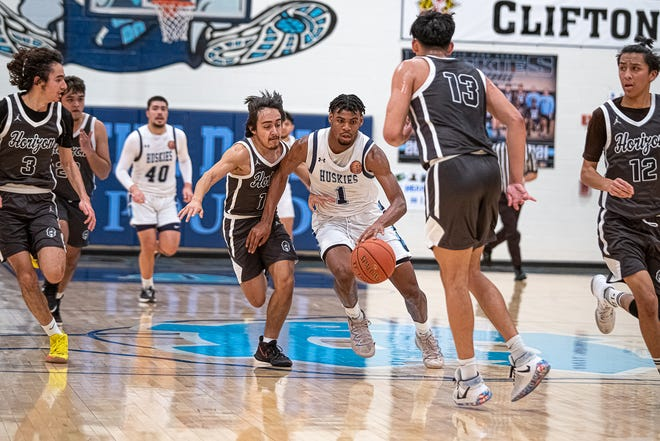 Chapin's KJ Lewis charges through a group of defenders. Chapin defeated Horizon High School 71-53 to win the Class 5A bi-district championship at Chapin High School on Feb. 19, 2021.