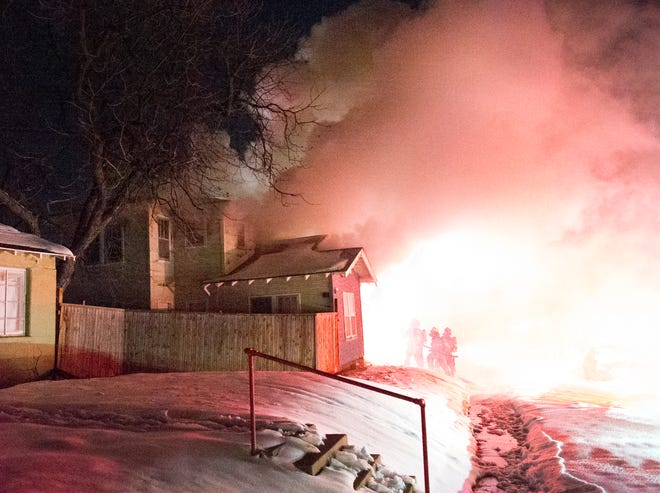 Wichita Falls Firefighter worked to control a 3-alarm structure fire Thursday night at a house on Sunset Drive.