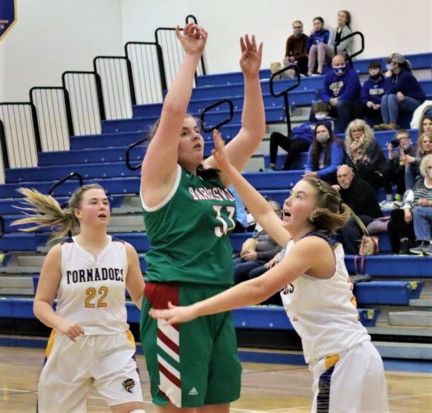 Barnesville's Anna Yater takes a shot over a West Muskingum defender during Thursday's Division III sectional final. The Tornadoes won 61-16.