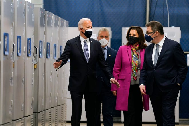 President Joe Biden tours a Pfizer manufacturing site, Friday, Feb. 19, 2021, in Portage, Mich. From left, Biden, Jeff Zients, White House coronavirus response coordinator, Michigan Gov. Gretchen Whitmer and Albert Bourla, Pfizer CEO.