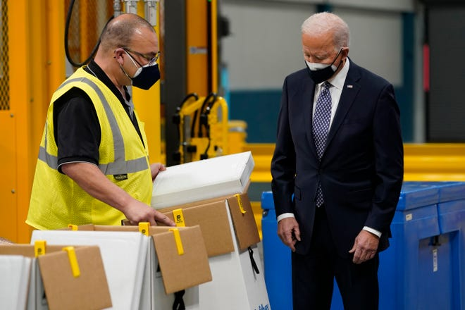 President Joe Biden tours a Pfizer manufacturing site, Friday, Feb. 19, 2021, in Portage, Mich.