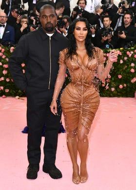 """Who could forget Kardashian's Thierry Mugler look at the 2019 Met Gala, that came with a <a href=""""https://www.usatoday.com/story/entertainment/celebrities/2019/07/08/kim-kardashian-talks-painful-met-gala-corset-kimono/1673979001/"""">corset</a> so tight she had to take <a href=""""https://www.instagram.com/p/BxTfoxlHXed/"""">lessons to breathe in it</a>? West accompanied her in a darker, and seemingly more comfortable, outfit."""