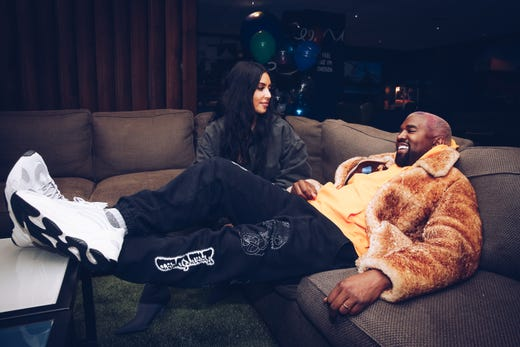 The couple got comfy on the couch atthe Travis Scott Astroworld Tour in Inglewood, Calif. on Dec. 19, 2018.
