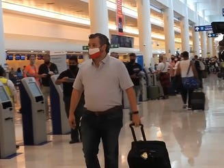 Sen. Ted Cruz, R-Texas, checks in for his flight back to the USA at Cancun International Airport in Mexico on Feb. 18.