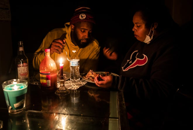 Howard and Nena Mamou eat dinner at their home in Glenwood neighborhood in Hutto, Texas on Tuesday, Feb 16, 2021 morning. Most homes in the area were without power for nearly 48 hours. Atmos Energy and other power companies were performing rotating outages to protect the electric grid.