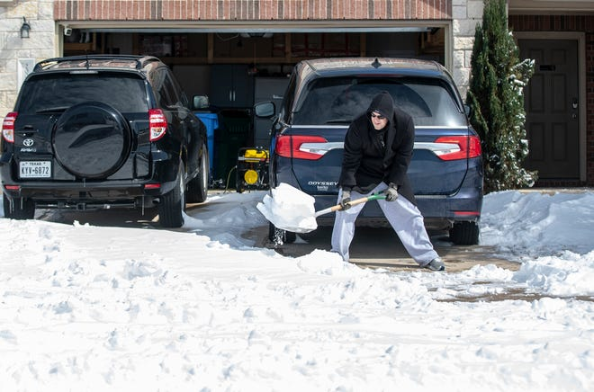 Jeremy Bixby shovels snow out of his driveway in the Blackhawk neighborhood in Pflugerville on Tuesday. The worst freeze to hit Central Texas decades startedFeb. 12 and lasted for six full days.