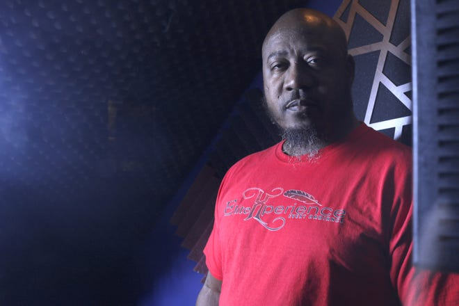 """Athens hip-hop artist and producer Darrin """"Elite tha Showstoppa"""" Ellison stands in the vocal booth of his self-designed home recording studio. After amassing hundreds of songs in his career, the Athens artist is working on his first album."""
