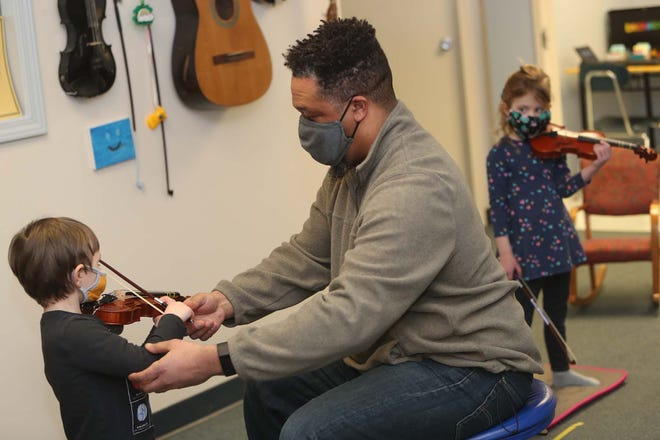 Jamieson Bowman leads a Suzuki violin class with students Anderson Ersahin, 3, left, of Akron and Nora Callard, 4, of Sharon Center at his studio, Violin Bowman, in Fairlawn.