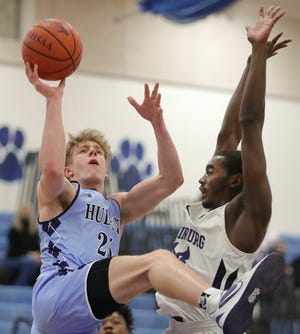 Hudson's Tyler Miller had 17 points and nine rebounds to lead the Explorers to a 61-33 win over Twinsburg on Friday night in Twinsburg. [Jeff Lange/Beacon Journal]