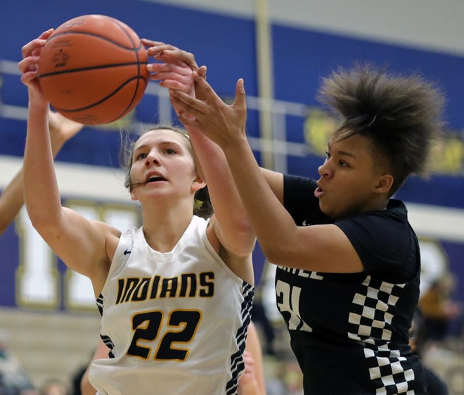 Copley's Ashley Kerekes, left, battles for a rebound with Buchtel's Amiyah Stallings during the second half of Copley's sectional final win over the Griffins on Saturday. [Jeff Lange/Beacon Journal]