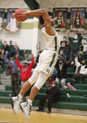 Ramar Pryor of St. Vincent-St. Mary flies through the air to slam the ball against visiting McKinley during the second half of their game Friday, Feb.19, 2021 in Akron. St. Vincent-St. Mary won 59-52.