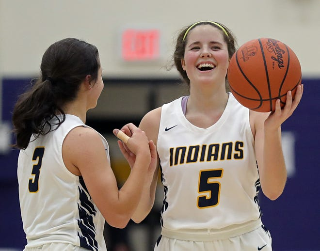 Copley's Shelby Emich, right, celebrates with Libby Blanchard after the Indians beat the Buchtel Lady Griffs in a Division II sectional final basketball game, Saturday, Feb. 20, 2021, in Copley, Ohio. [Jeff Lange/Beacon Journal]