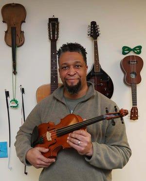 Jamieson Bowman in his studio, Violin Bowman, in Fairlawn.