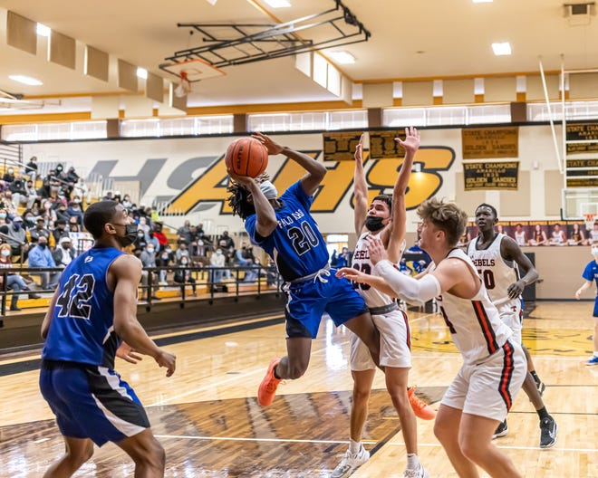 Palo Duro player Kadden Price goes for a shot during Friday's win over Tascosa. [Tom Carver/for the Amarillo Globe-News]