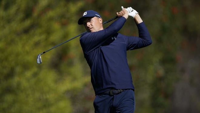 Jordan Spieth tees off on the fourth hole during the second round of the Genesis Invitational golf tournament at Riviera Country Club Friday. Spieth fired his second consecutive 3-under-par 68 Friday to move into contention.