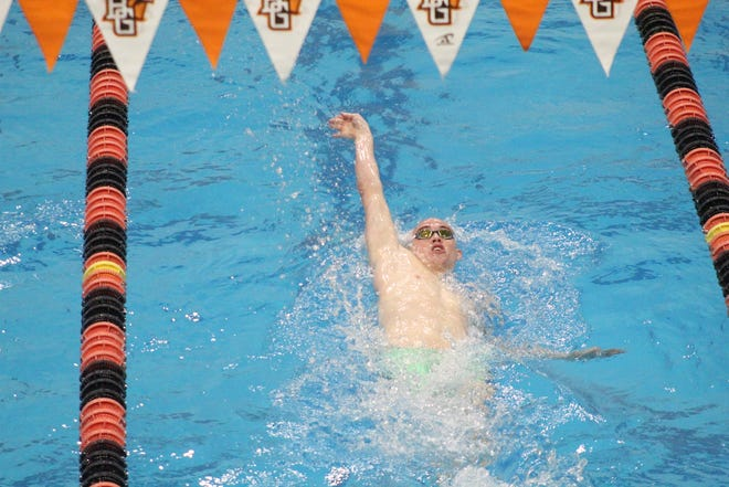 Crestview's Ross Kuhn competes in the 100 backstroke Friday at the Div. II Northwest District competition.