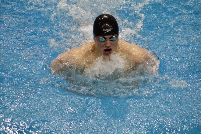 Ashland's Rylan McDaniel competes in the 100 breaststroke Friday at the Div. II Northwest District competition. McDaniel won the event.