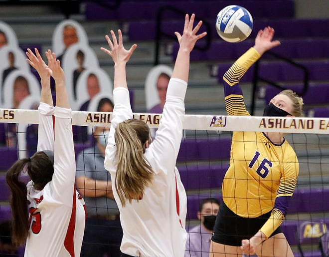 Ashland's Erin Krupar (16) hits a shot at the net against Davenport's Riley Groves (15) and Megan Herr during college volleyball action Friday at Kates Gymnasium.