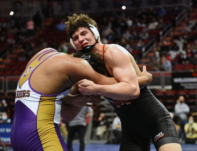Ames' Gabe Greenlee locks up with Norwalk's Maddux Borcherding-Johnson during the Class 3A semifinals of the state wrestling tournament at 285 pounds Friday in Des Moines. Greenlee won by a 3-1 decision to advance to the finals with a 34-0 record to take on Bettendorf's Griffin Liddle (26-1) in a rematch of last year's title match.