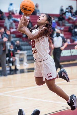 Cross Creek's Michaela Bogans leaps toward the basket to take a shot during basketball action against Morgan County at Cross Creek High School in Augusta, Ga., Friday evening February 19, 2021.