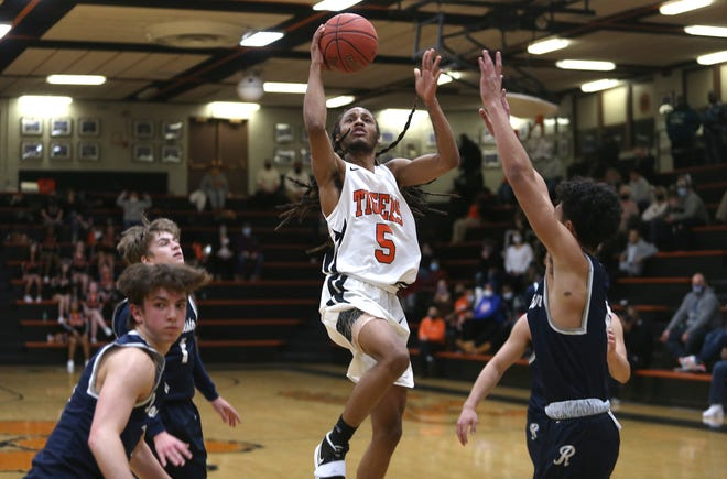 Beaver Falls' Michael Conley (5) goes to the basket for a layup during the second half against the Rochester Rams Friday night at Beaver Falls Middle School.