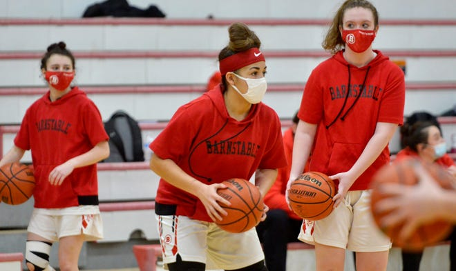 Olivia Gourdine, center, warms up with her teammates before a recent game with Nantucket. Barnstable's small forward and junior captain heads into the final week of the season as one of the best shooters on the Cape. To see more photos, go to www.capecodtimes.com.