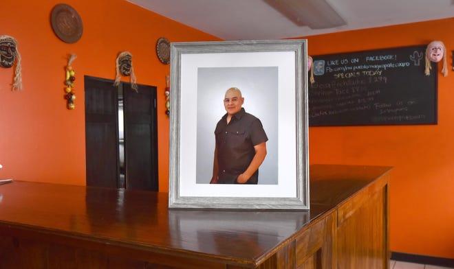 Mi Pueblo, a restaurant in Hyannis, Mass., displays a portrait of its owner, Enrique Valdovinos, who died of COVID-19.