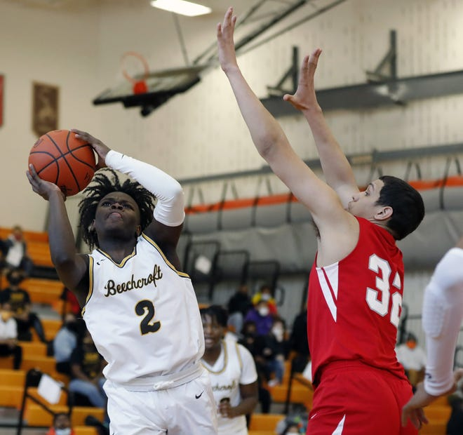 Beechcroft's J.J. Simmons goes up for a shot against Walnut Ridge's Tyree Morgan during the first half of the City League championship game at East High School on Saturday.