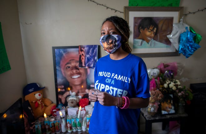 """Rachelle Knight created a shrine to her 19-year-old son, Dontreal Calhoun, who was shot and killed on Jan 3. """"I don't know what is wrong with the world,"""" she said."""