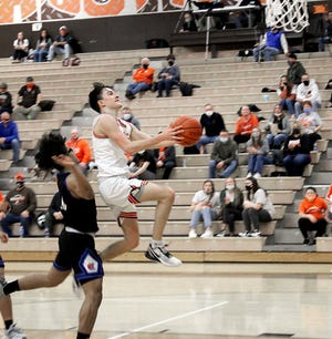 Meadowbrook junior Jake Singleton (3) glides in for a layup during Friday's 63-46 home court win over Zanesville. Singleton finished with 26 points for the Colts who improved to 20-2 on the season.