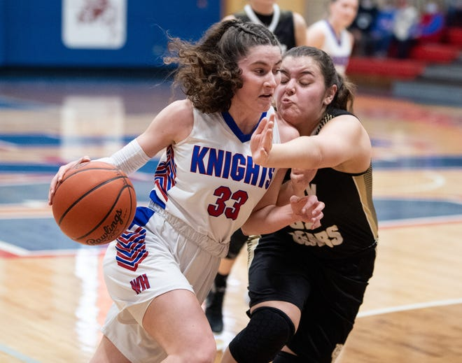 Katie Sprang drives to the basket for West Holmes.