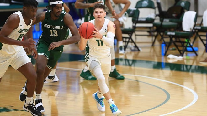 Stetson's Chase Johnston (11) scored a season-high 24 points to lead the Hatters past Jacksonville, 91-75, in ASUN Conference action, Friday at Edmunds Center. Feb. 19, 2021.