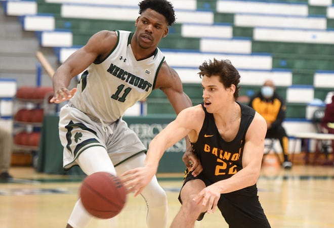 Gannon's Ryan Rachic, right, passes around Mercyhurst's Daniel Ogele during the Lakers' 83-61 win on Feb. 20 at the Mercyhurst Athletic Center. The teams will meet Saturday at the Hammermill Center.